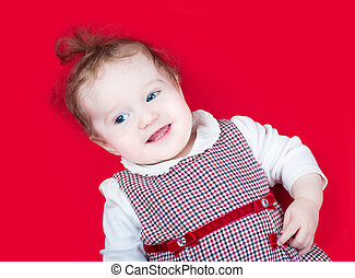 Funny laughing baby girl in red Christmas dress