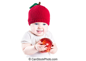 Funny little baby with a big red apple