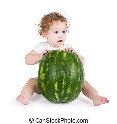 Funny little baby with a big watermelon, on white background