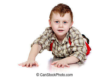 Funny little boy crawling on the floor