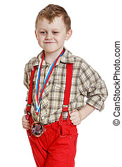Funny little boy in red shorts with suspenders, close-up