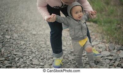 Funny little boy learns to walk