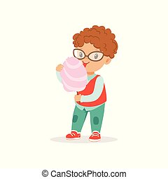 Funny little boy with shiny eyes eating sweet cotton candy. Cartoon kid character with curly red hair wearing glasses, shirt, vest and jeans. Flat vector design