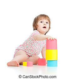Funny little child playing with cup toys, isolated over white