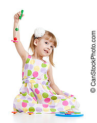 Funny little child playing with toys, isolated over white