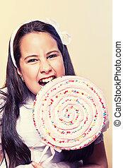 Little Girl Biting a Big Lollipop