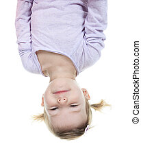 funny little girl hanging upside down on white