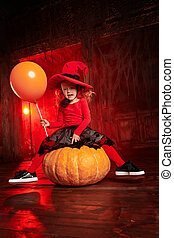 little girl in a witch costume