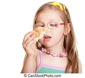 Funny little girl in glasses eating bread doing fun isolated