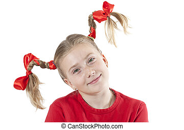 Funny little girl in pigtails
