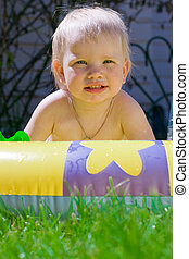 Funny little girl in yellow pool