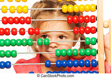 Funny little girl peeping out colorful abacus - Little funny...