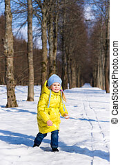 Funny little girl playing in winter