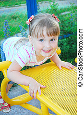 funny little girl playing on the playground.