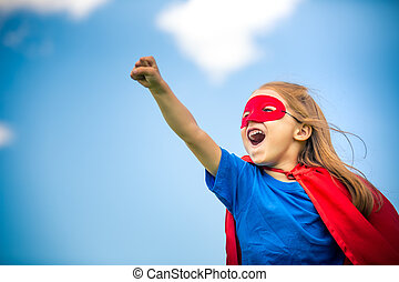 Funny little girl playing power super hero. - Funny little...