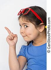 funny little girl pointing finger. nice school girl wearing glasses