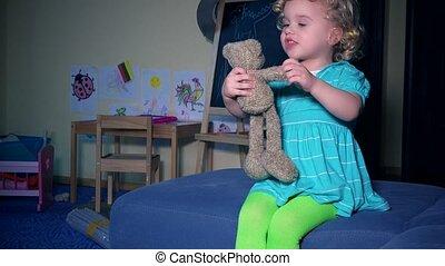 funny little girl tell story for best friend plush teddy bear. emotional child