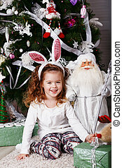 Funny little girl with bunny ears.