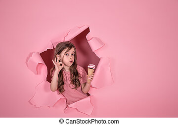 funny little girl with ice cream on colored background