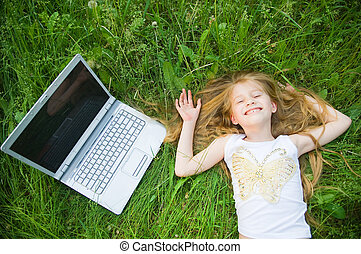 Funny little girl with laptop