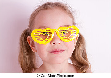Funny little girl with silly glasses