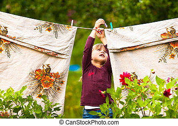 Funny little girl with the clothesline