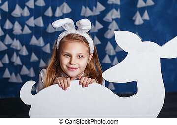 Funny little girl with white bunny ears