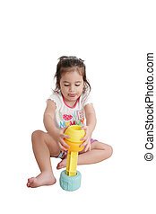 Funny little kid playing with toys, isolated over white