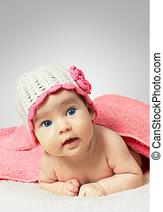 Funny little newborn baby wearing a hat with flower - Funny...
