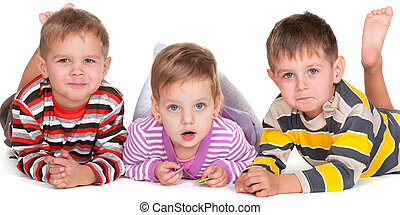Funny lying kids in striped shirts