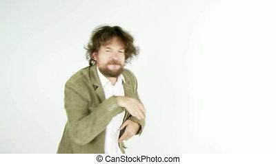 Funny man dancing in studio