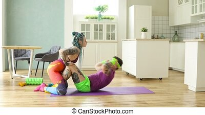 Funny man doing abs exercises crunches with wife kissing her, fitness humor.