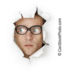 Funny man in an old-fashioned glasses looking out of hole