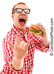 Funny man in glasses eating hamburger