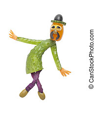Funny man in hat made of vegetables