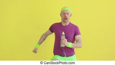 Funny man is running with bottle in hands and breathing, sportive humor.