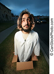 Funny man looking like Jesus coming out of the box. Wide angle.