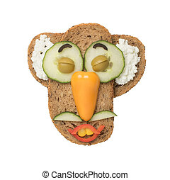 Funny man made with vegetables on slices of bread