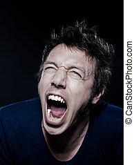 Funny Man Portrait screaming - studio portrait on black...