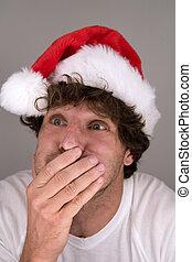 funny man wearing Santa hat