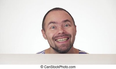 Funny man with a beard showing emotions on white background...