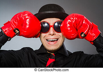 Funny man with boxing gloves