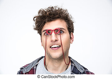 Funny man with curly hair looking through small glasses at camera