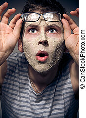 Funny man with facial mask and glasses