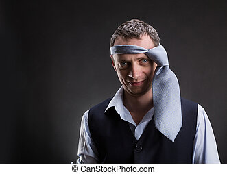 Funny man with necktie on his head