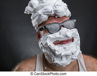 Funny man with shaving foam covered face - Strange smiling...