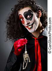 Funny man with skeleton in hands