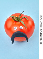 Funny manlike tomato with moustache. Red male tomatoe ...