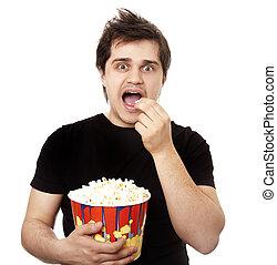 Funny men eating popcorn.
