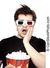 Funny men in stereo glasses with popcorn.